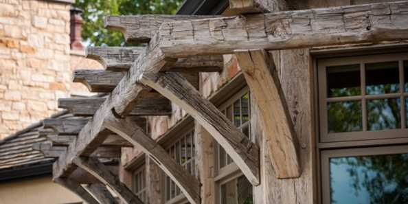 Reclaimed hand-hewn white oak timber trusses, purlins, rafters and beams bring historic character and life to every angle of the exterior.